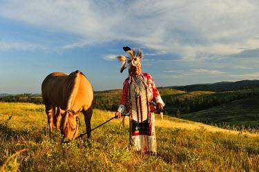 USA8672AW Lakota Indian in the Black Hills with Horse, Western South Dakota, USA. MR