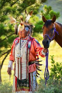 USA8682AW Lakota Indian in the Black Hills with Horse, Western South Dakota, USA. MR
