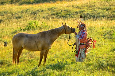 USA8683AW Lakota Indian in the Black Hills with Horse, Western South Dakota, USA. MR