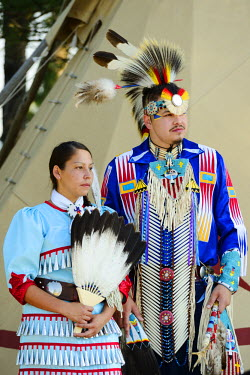 USA8687AW Lakota Woman and man  in full regalia, Custer County, Black Hills National Forest, Western South Dakota, USA. MR
