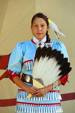 USA8688AW Lakota Woman in full regalia, Custer County, Black Hills National Forest, Western South Dakota, USA. MR