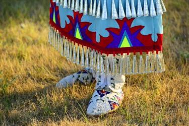 USA8690AW Lakota Woman in full regalia, Custer County, Black Hills National Forest, Western South Dakota, USA . MR