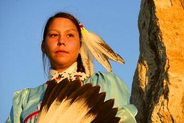 USA8691AW Lakota Woman in full regalia, Custer County, Black Hills National Forest, Western South Dakota, USA. MR