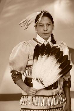 USA8692AW Lakota Woman in full regalia, Custer County, Black Hills National Forest, Western South Dakota, USA MR