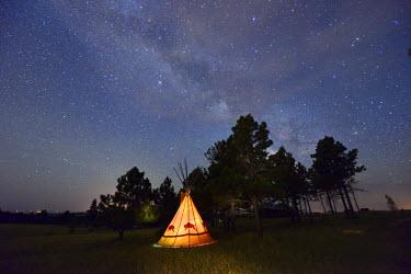 USA8693AW Tipi camp at night,Lakota Sioux Tipis, Custer County, Black Hills, Western South Dakota, USA