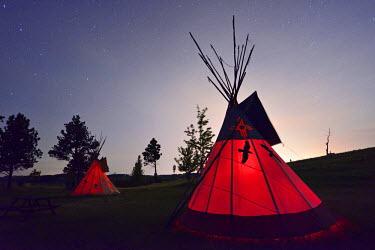USA8694AW Tipi camp at night,Lakota Sioux Tipis, Custer County, Black Hills, Western South Dakota, USA