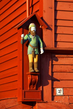 HMS0543037 Norway, Hordaland County, Bergen, Bryggen, listed as World Heritage by UNESCO, former counter the Hanseatic League (Hanse),�statue of St Jack on a wooden house�facade