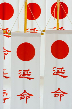 JP03559 Asia, Japan, Honshu, Kansai Region, Nara, flags hanging outside Kasuga Taisha Shrine