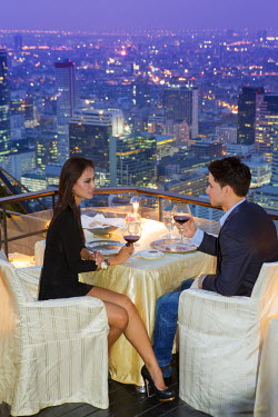 THA0455AW South East Asia, Thailand, Bangkok, Sathorn district, Banyan Tree, a couple dining at the Vertigo restaurant overlooking metropolitan Bangkok (MR)