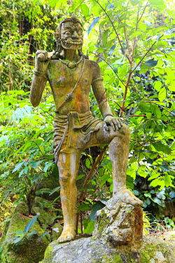 South East Asia, Thailand, Surat Thani Province, Ko Samui, Secret Buddha Garden, also known as Heaven's Garden or Magic Garden, s statue of a demon in the garden