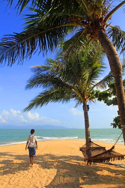South East Asia, Thailand, Surat Thani Province, Ko Samui, Mae Nam, a woman walking along Mae Nam beach