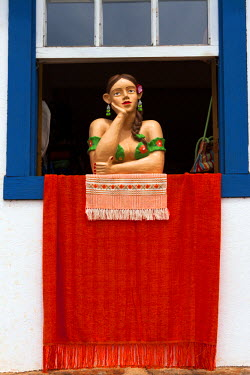 BRA1932AW South America, Brazil, Minas Gerais state, Tiradentes, traditional sculptures in a shop window in the town centre