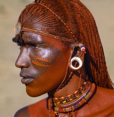 KEN8208 Kenya, Maralal, Samburu County.  A handsome Samburu man wearing the traditional long braided and ochred hair of all Samburu warriors.