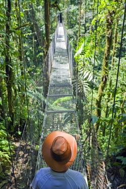 CR32946AW Man on hanging bridge, La Fortuna, Costa Rica