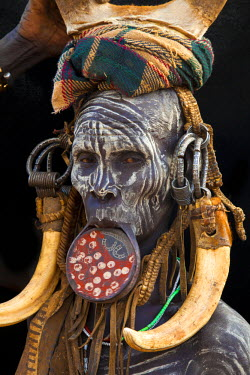 AF16BJY0003 Africa, Ethiopia, Omo River Valley. Mursi tribe woman with lip ring and decorations.