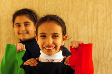 AS19AAS0014 Kuwait, Kuwait City, of 2 smiling girls disguised with Kuwaiti flag. (MR)