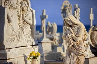 CA27BJN0013 Memorial Angel at a family grave plot in historic Cemeterio Santa Maria Magdalena de Pazzis, San Juan, Puerto Rico.