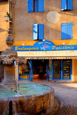 EU09BJN0463 Bakery and water fountain in village of Valensole, Provence, France.