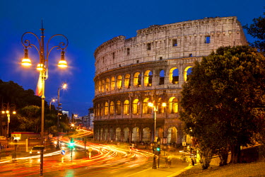 EU16BJN0141 Car light-trails in front of the Roman Coliseum at dusk, Rome, Lazio, Italy.