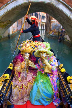 EU16BJY0040 Europe, Italy, Venice. Two women in gondola dressed in elaborate costume for Carnival festival.