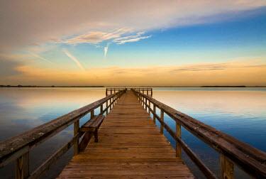 US10RDU0017 USA, Florida, Terre Ceia Bay. Sunrise on the pier on Terre Ceia Bay on Florida's Gulf Coast.