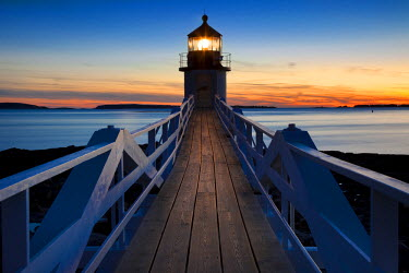 Sunset at Marshall Point Lighthouse, built 1832, near Port Clyde, Maine, USA.