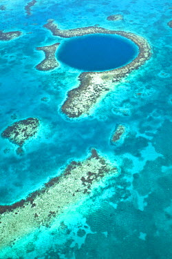 BLZ0180AW Central America, Belize, Lighthouse atoll, the Great Blue Hole, aerial shot of the Blue Hole. The hole is a marine cenote - a sunken cave in the Lighthouse atoll, part of the World Heritage listed Bel...