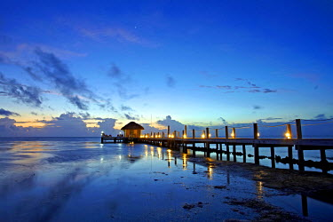 BLZ0194AW Central America, Belize, Ambergris Caye, San Pedro, dawn over the Caribbean sea and an illuminated jetty