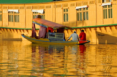 IND7469 India, Jammu & Kashmir, Srinagar. Small wooden boats are often used by tourists to access Dal Lake's celebrated houseboats and by locals to cross sections of the lake and its nearby channels.