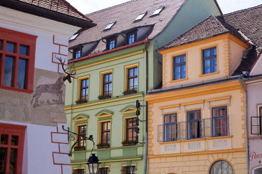 ROM0109 Romania, Transylvania, Sighisoara. The Casa cu Cerb hotel amidst colourful houses situated within the medieval fortress of Sighisoara.