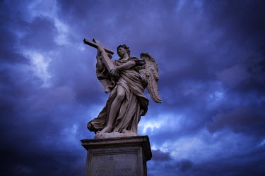 AR4854300029 The statue Angel with a Cross, by Ercole Ferrata, Ponte Sant'Angelo, Rome the day before the start of conclave and the picking of the new Pope in Vatican City, Italy