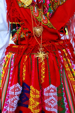 POR7336AW Gold necklace and traditional costume (Lavradeira) of Minho. Our Lady of Agony Festivities, the biggest traditional festival in Portugal. Viana do Castelo.