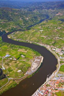 POR7374AW Europe, Portugal, Tras-os-Montes e Alto Douro, Douro Valley aerial view of vineyards and vineyard terraces and the Douro (Duero) river in the UNESCO World Heritage listed Alto Douro region