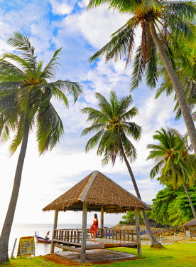 Thailand, Ko Samui, Chaweng beach, woman resting in beach hut (MR)