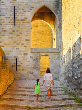 FRA7953AW France, Languedoc, Carcassonne, Woman and girl walking (MR)