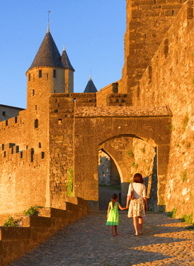 FRA7954AW France, Languedoc, Carcassonne, Woman and girl walking to Aude gate (MR)