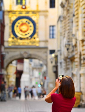 FRA7986AW France, Normandy, Rouen, Le Gros Horloge, Woman photographing clock (MR)