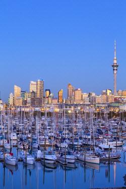 NZ01249 Westhaven Marina & city skyline illuminated at dusk, Waitemata Harbour, Auckland, North Island, New Zealand, Australasia