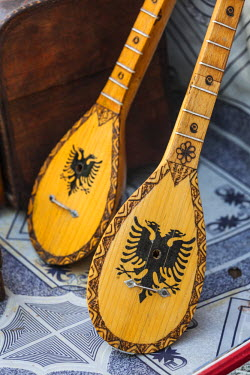 AL01049 Albania, Kruja, town bazaar, mandolins
