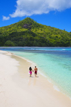 SC01182 Couple walking along the beach, Mahe, Seychelleshands