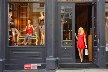 USA8845AW Woman walking out of Lingerie store, Soho,New York, Manhattan, USA MR