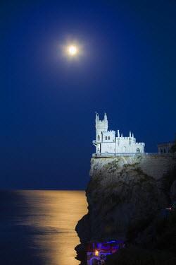 UA02146 Ukraine, Crimea, Yalta, Gaspra, Full moon over  shines over The Swallow's Nest castle perched on Aurora Clff