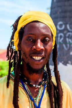 AF02ALA0015 Africa, Angola, Benguela. Portrait of young Rastafarian man.