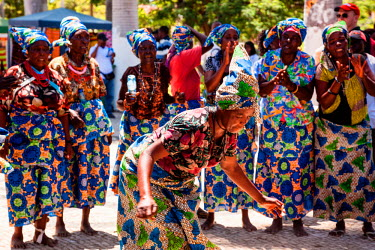AF02ALA0022 Africa, Angola, Benguela. Women dancing in traditional dress.