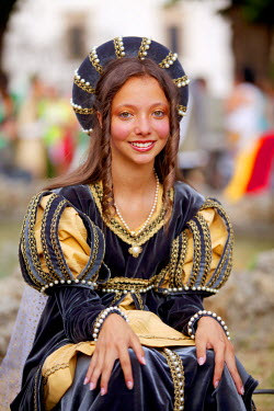 ITA2372 Italy, Tuscany , Pistoia.Young woman in Medieval costume for the annual parade on the feast of San Jacopo