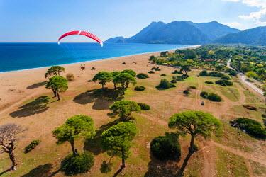AS37AKA1948 Paramotor flying over Olympos beach, Antalya, Turkey