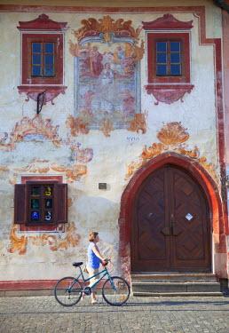 SLV1204AW Woman walking past decorative building in Radnicne Square, Bardejov (UNESCO World Heritage Site), Presov Region, Slovakia