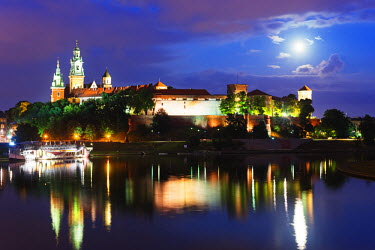 POL1242 Europe, Poland, Malopolska, Krakow, full moon over Wawel Hill Castle and Cathedral, Vistula River, Unesco site