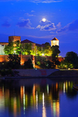 POL1243 Europe, Poland, Malopolska, Krakow, full moon over Wawel Hill Castle and Cathedral, Vistula River, Unesco site