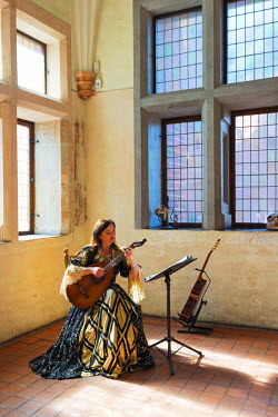 POL1469 Europe, Poland, Pomerania, musician inside the medieval Malbork Castle, Marienburg Fortress of Mary, Unesco site